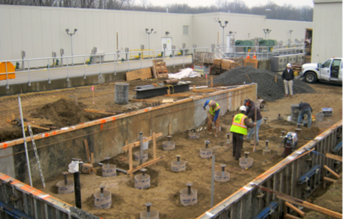 Using helical piles for a foundation on new construction.